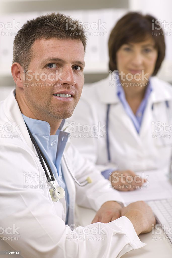 Doctors working at office royalty-free stock photo