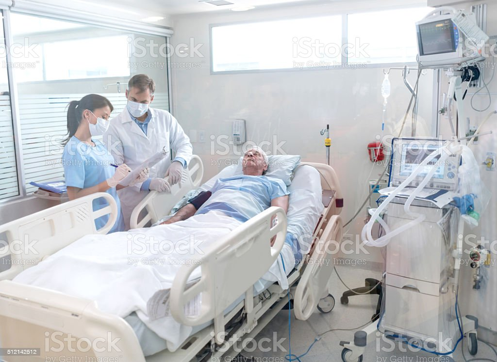 Doctors working at the hospital stock photo