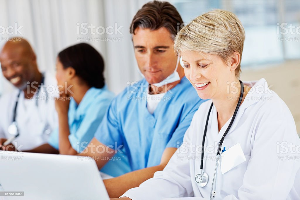 Doctors working on a laptop together royalty-free stock photo
