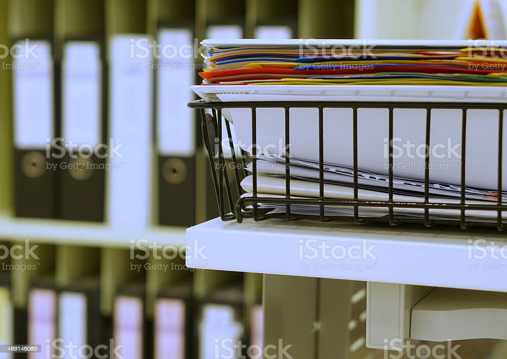 Document in basket at office stock photo