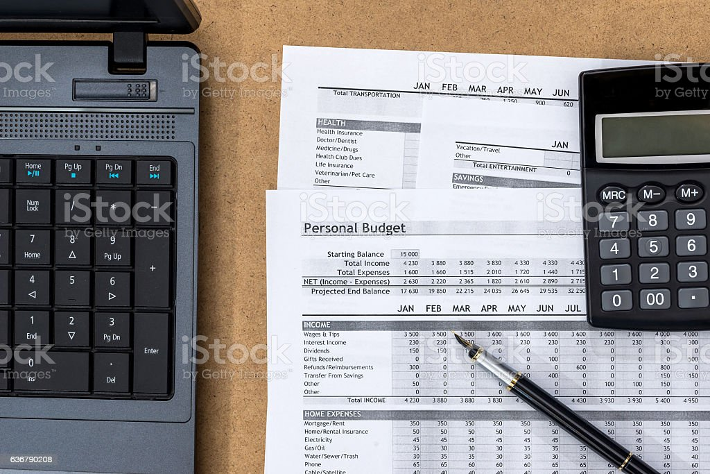 Document - Personal Budget with a laptop, a calculator and stock photo
