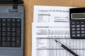 Document - Personal Budget with a laptop, a calculator and