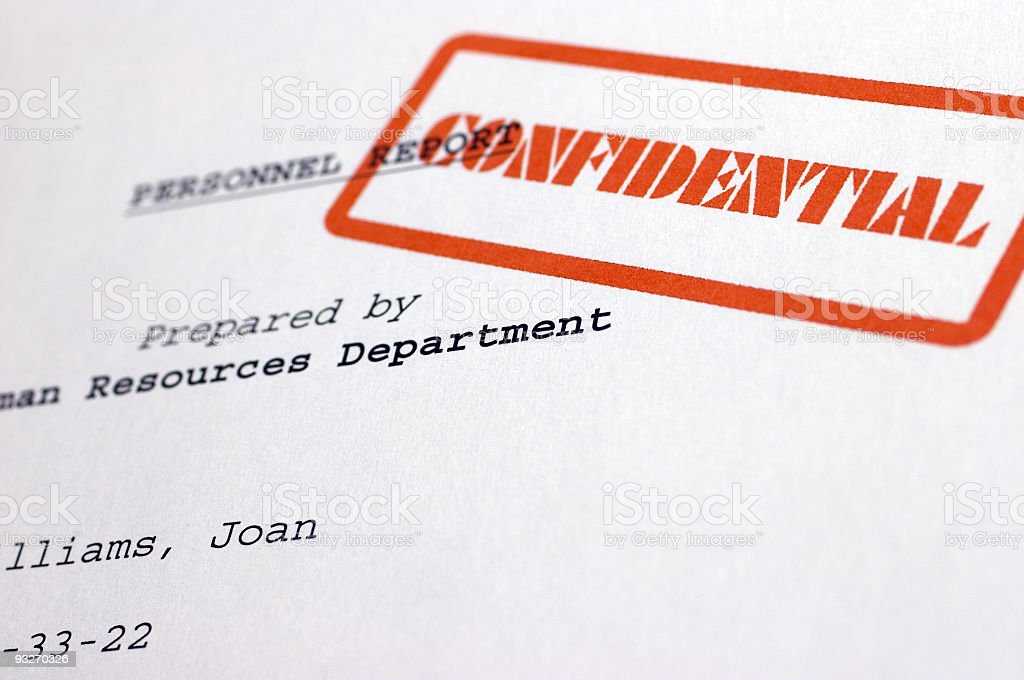 A document stamped with the word confidential royalty-free stock photo
