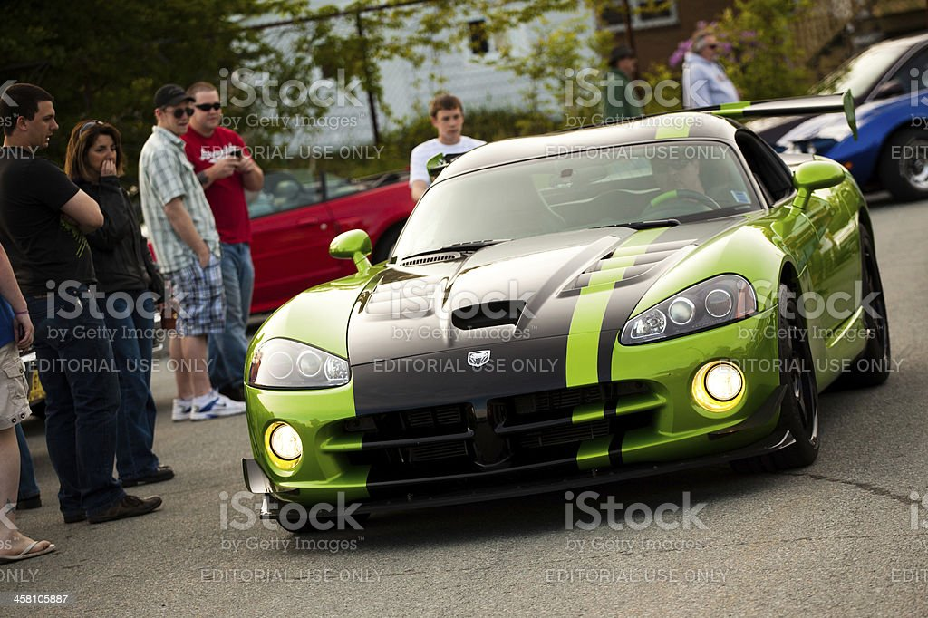 Dodge Viper ACR driving in parking lot at dusk stock photo