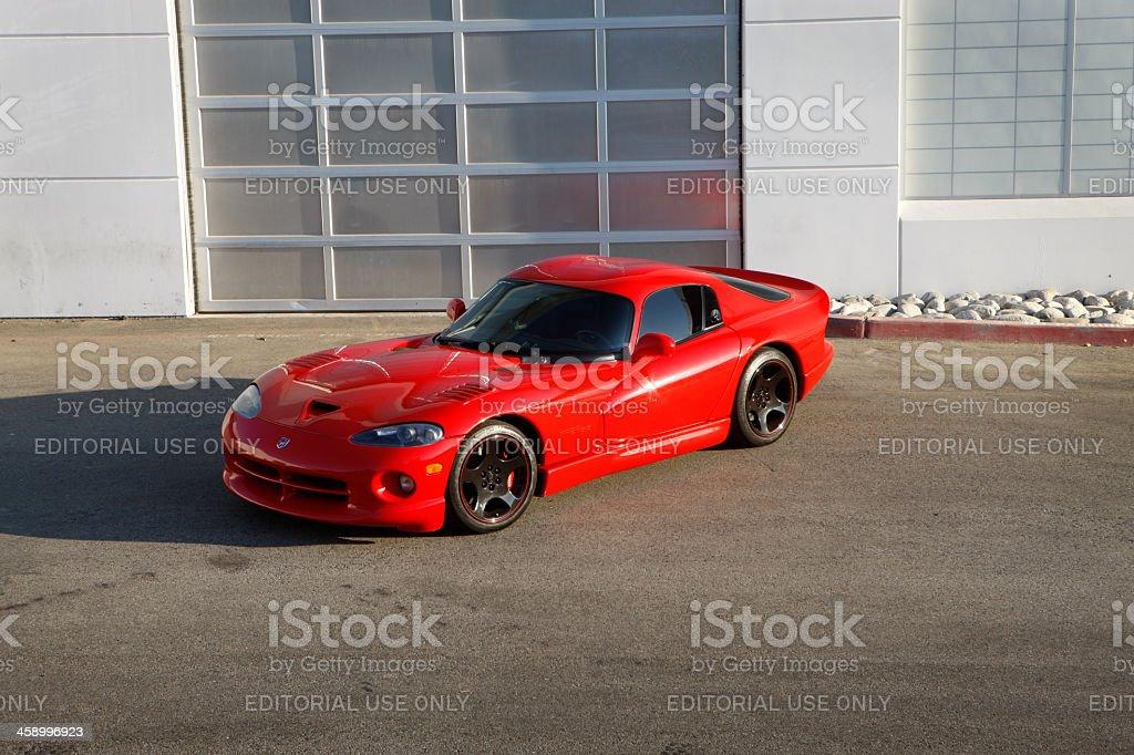 Dodge Viper GTS in front of garage door stock photo