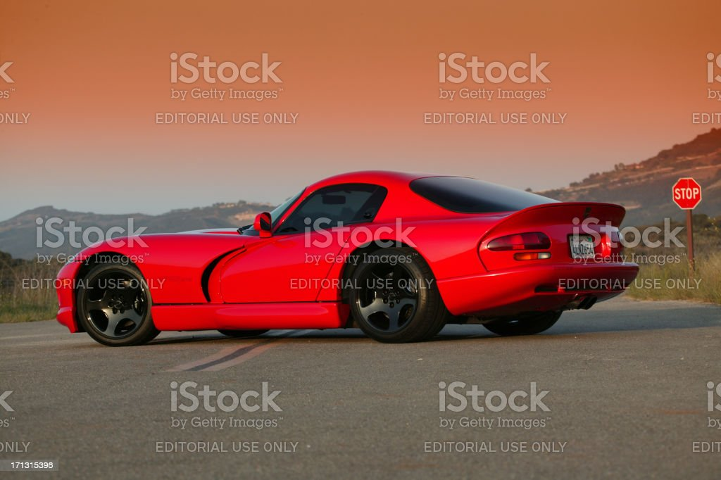 Dodge Viper GTS on double yellow with stop sign stock photo