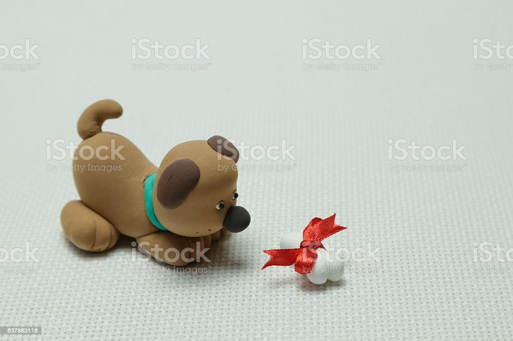 Dog and a bone tied up by a band stock photo