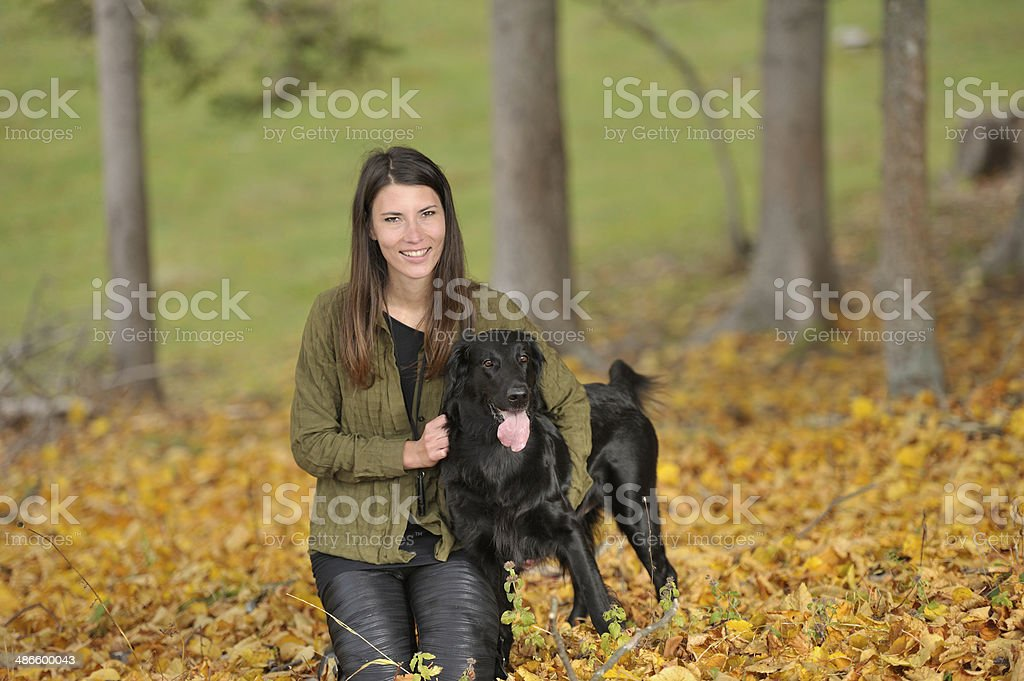 Dog and woman at the edge of forest royalty-free stock photo
