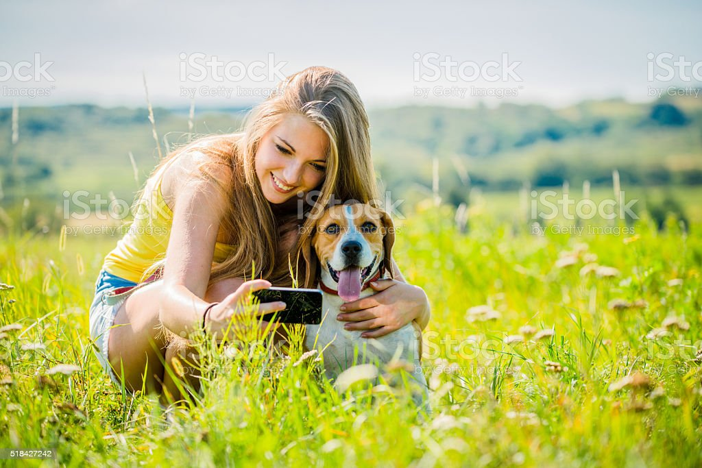 Dog and woman - happy life stock photo