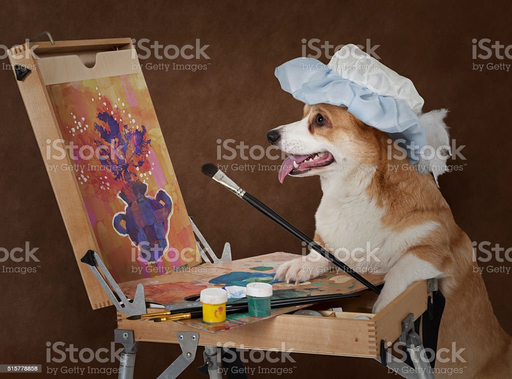 Dog artist painting still life with flowers stock photo