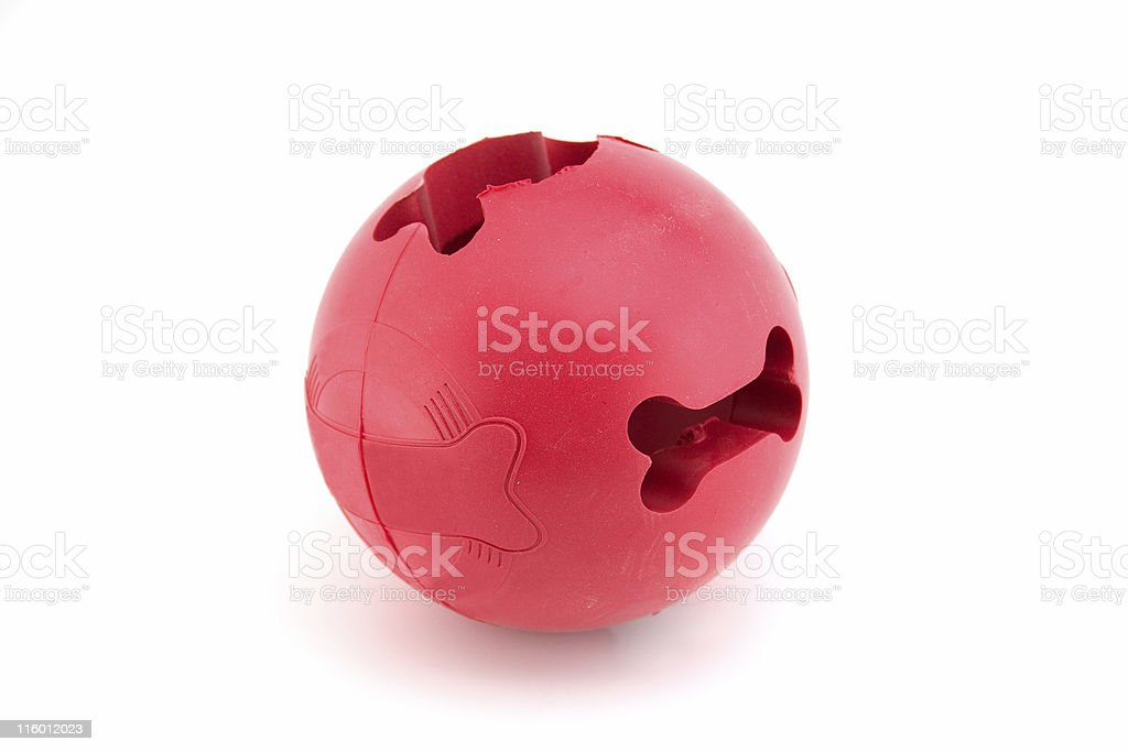 Dog ball with holes for bones and treats stock photo