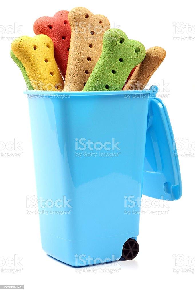 dog biscuits inside a wheelie bin stock photo