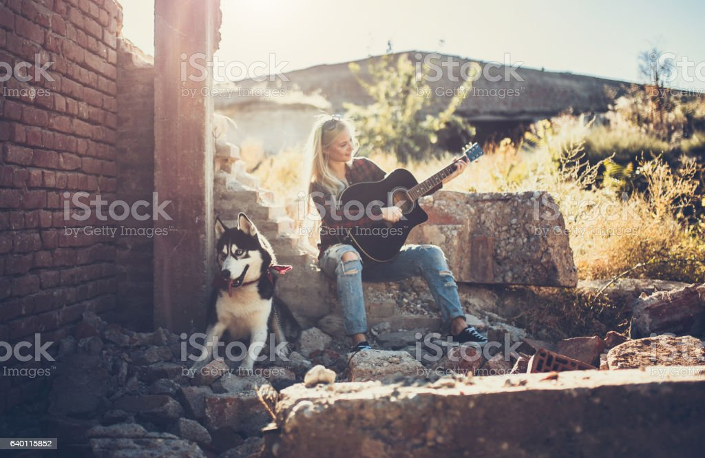 Dog, music and nature is all I need stock photo