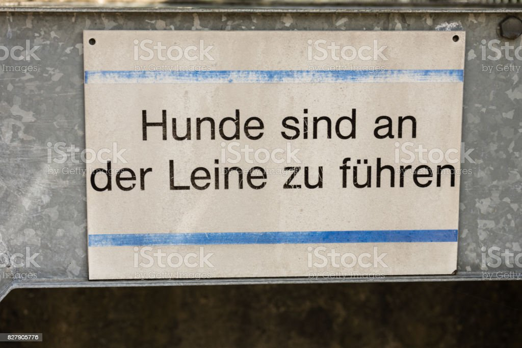 dog on leash sign in german stock photo