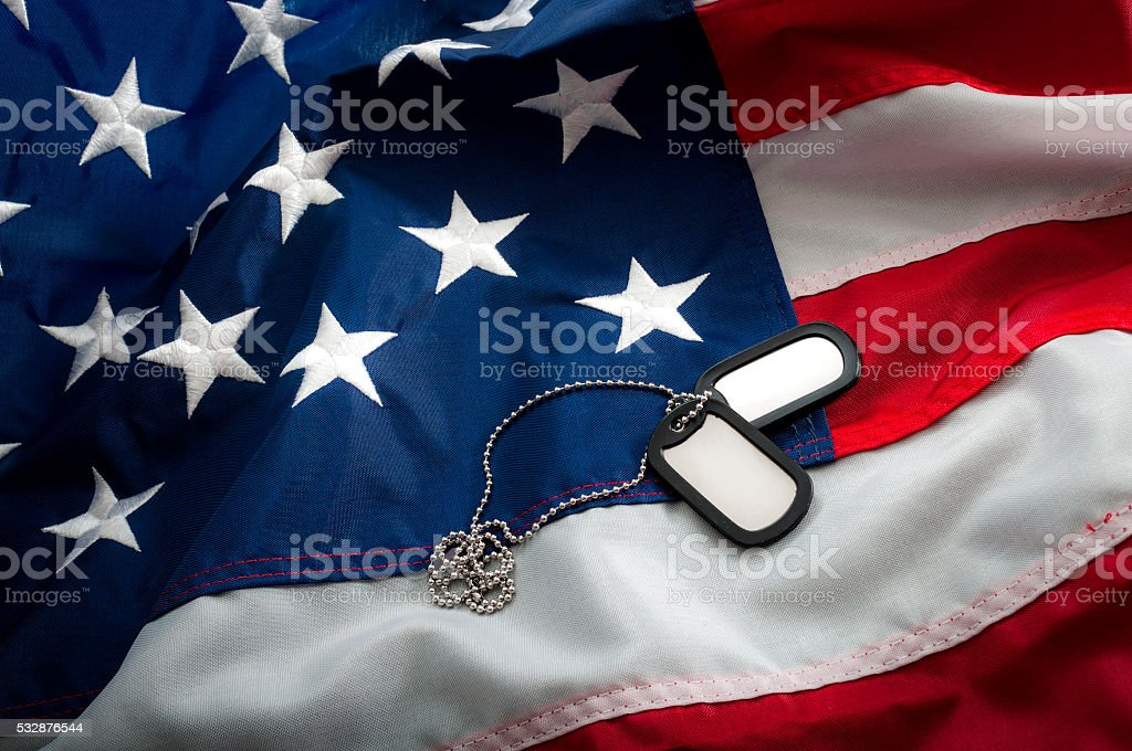 Dog tags and the American flag stock photo