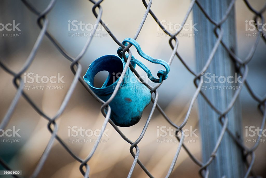 Dog toy on a fence stock photo