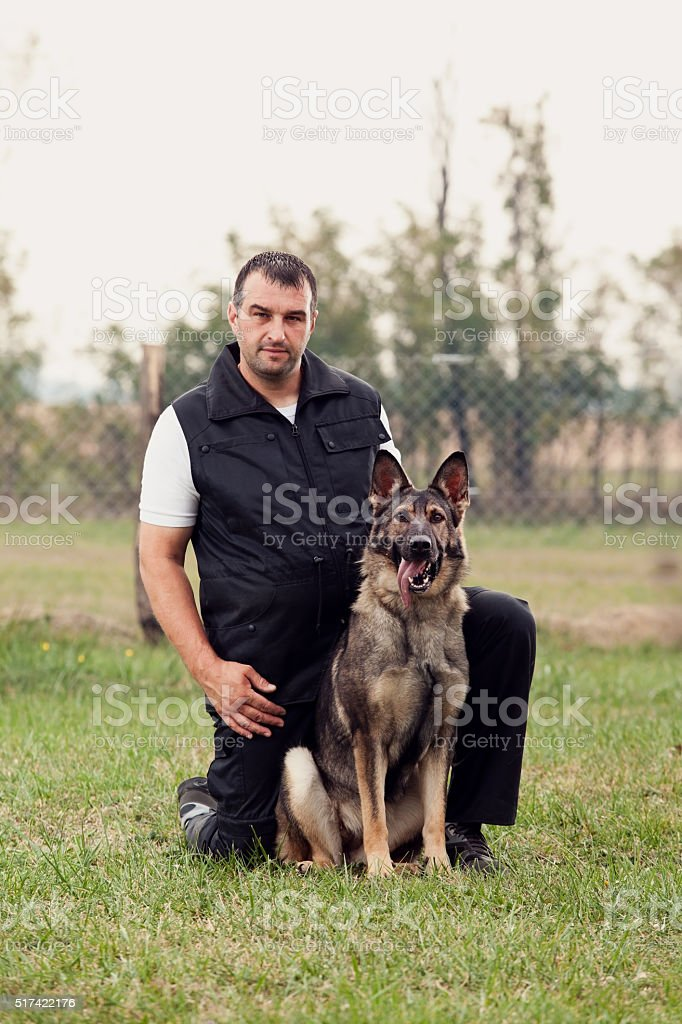 Dog trainer with a german shepherd stock photo