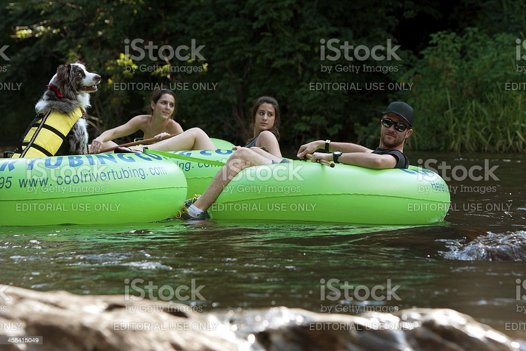 Dog Tubes Down North Georiga River With Owner stock photo