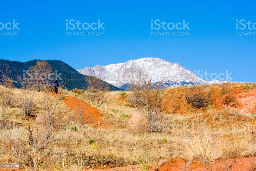 Dog Walking at Red Rocks Open Space royalty-free stock photo