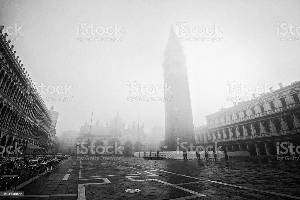 Doge Palace and St Mark's Campanile on a foggy morning stock photo