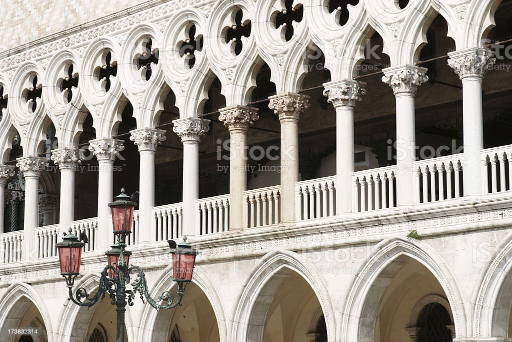 Doges Palace detail in Venice with street lamp royalty-free stock photo
