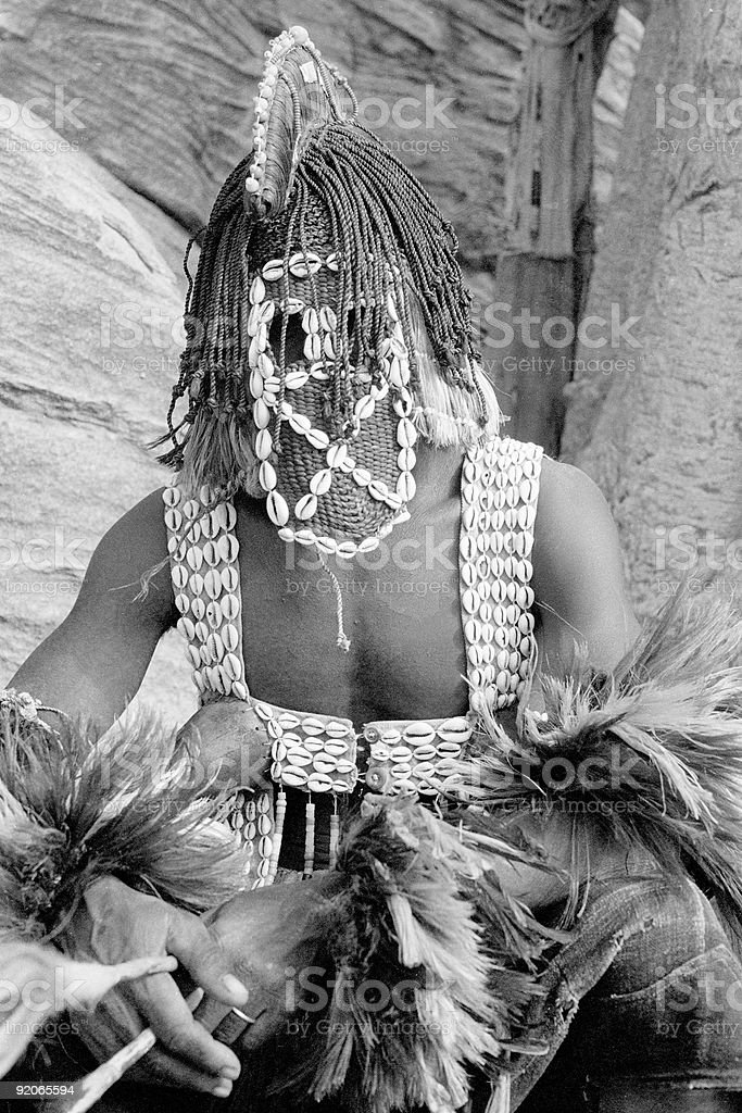Dogon Dancer with Cowrie Shell Mask stock photo
