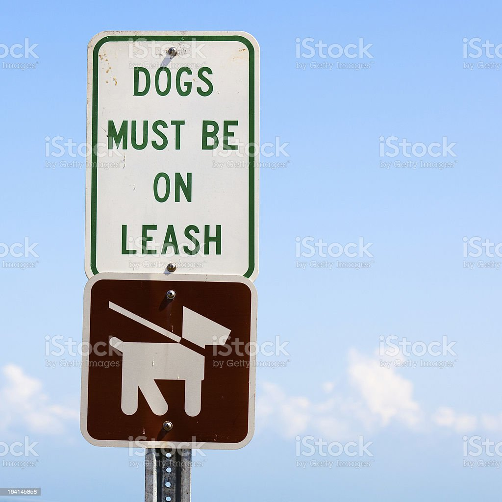 Dogs Must Be On Leash Sign stock photo