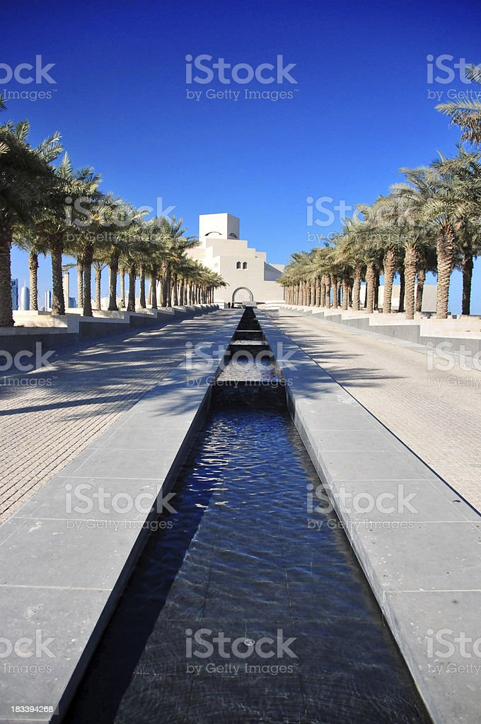 Doha: Islamic Art Museum - palm-tree lined avenue stock photo
