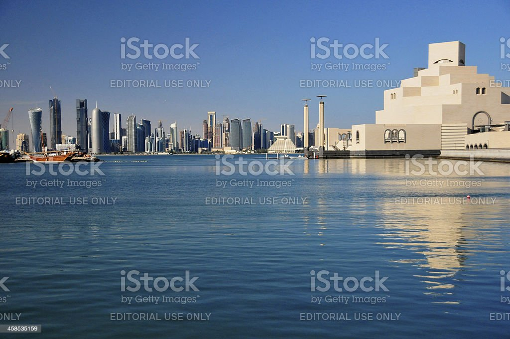 Doha, Qatar: Museum of Islamic Art reflected on the bay stock photo