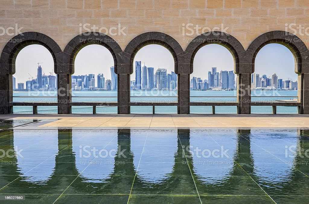 Doha skyline and arches at Museum of Islamic art, Qatar stock photo
