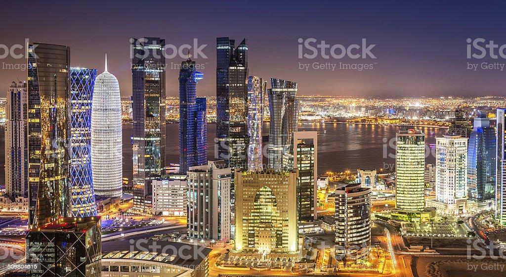 Doha Skyline Panorama, Qatar Cityscape from Above at Night stock photo