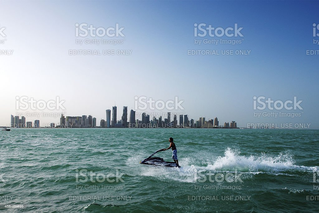 Doha's Corniche West Bay area is a popular exercise location stock photo