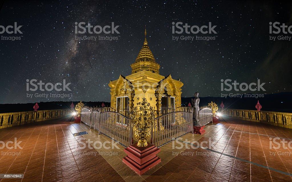 Doi sappanyoo temple with milky way (with noise) stock photo