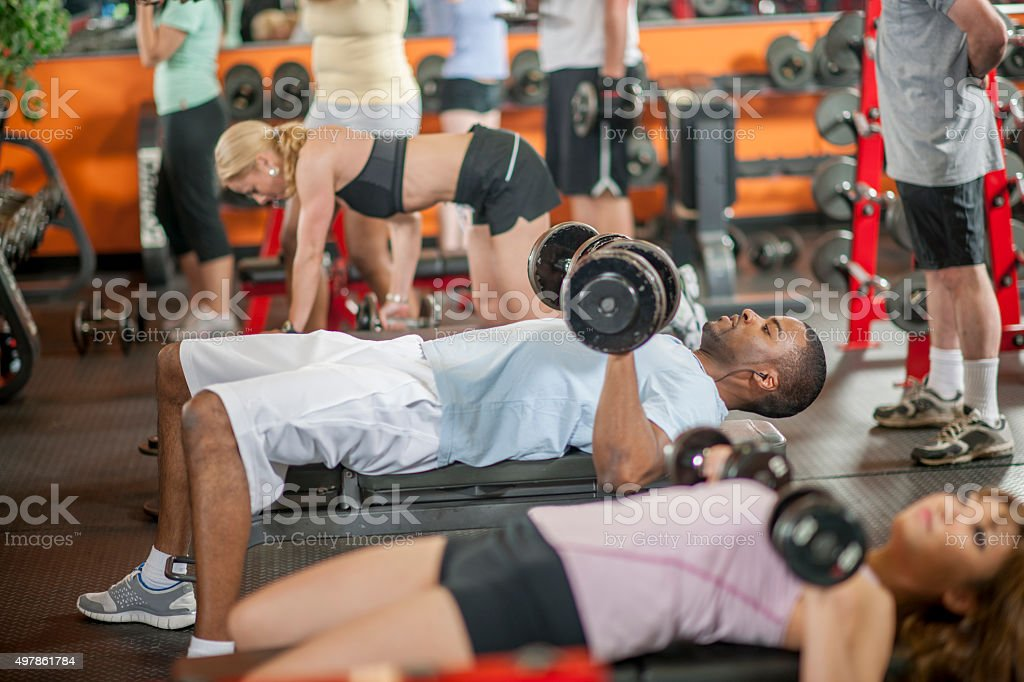 Doing a Bench Press at the Gym stock photo