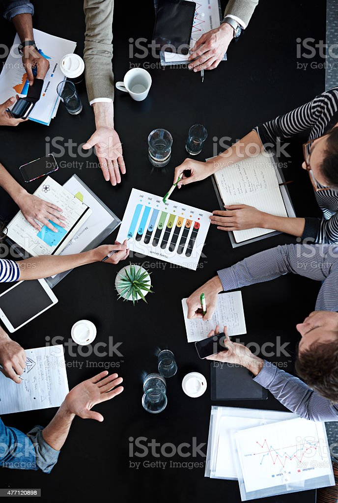Doing a cost-benefit analysis stock photo