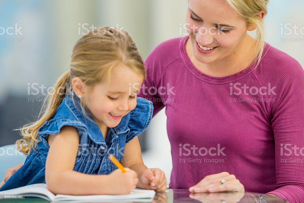 Doing a Home school Assignment stock photo