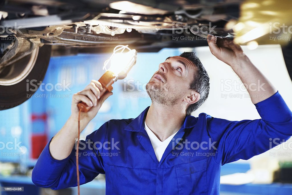 Doing a thorough inspection for flaws stock photo