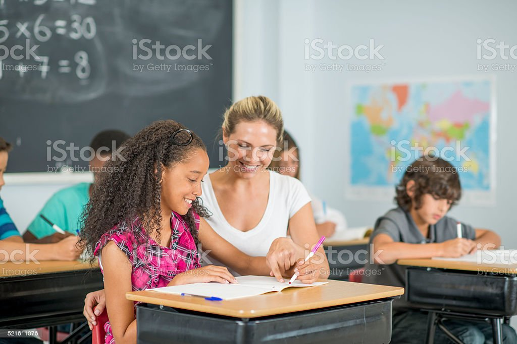 Doing an Assignment in Class stock photo