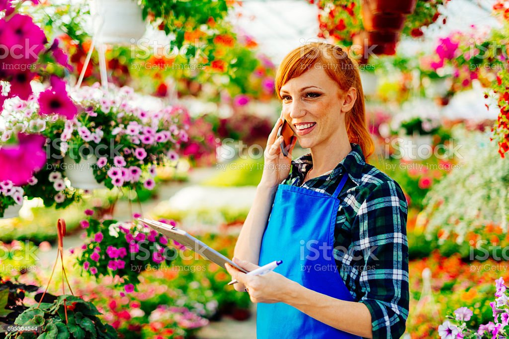 Doing business in flower shop stock photo