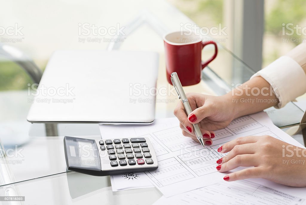 Doing calculations stock photo