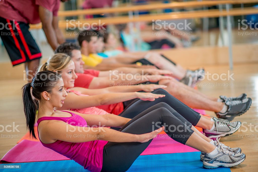 Doing Crunches Together stock photo