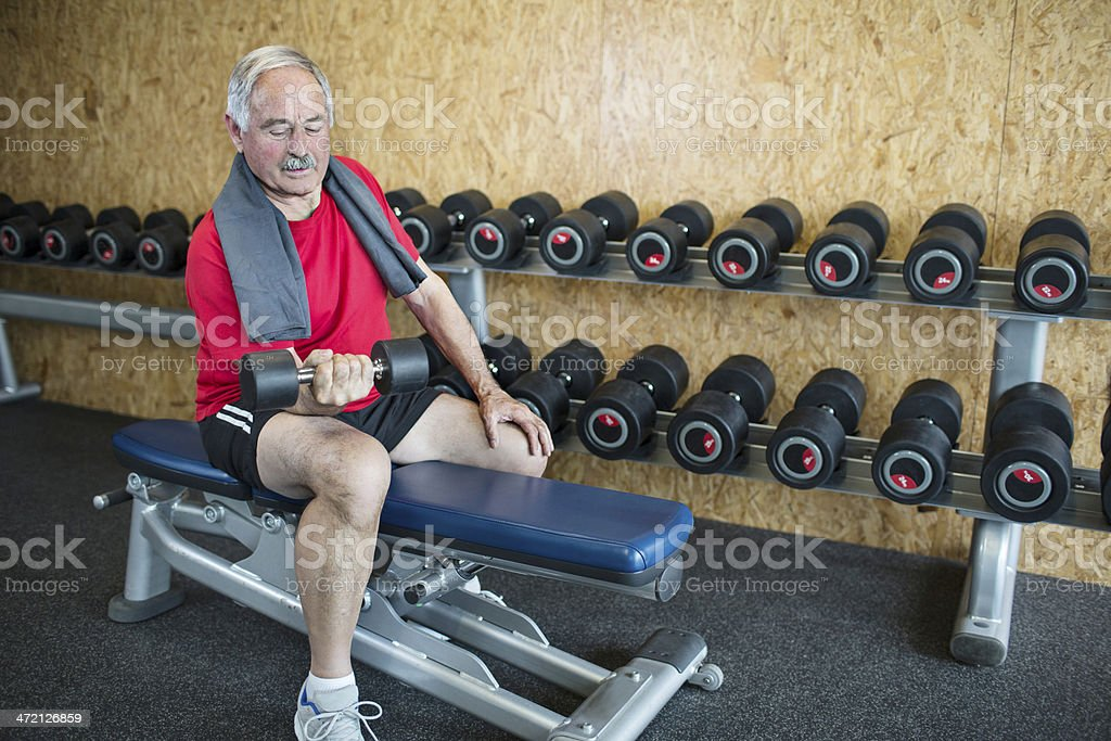 Doing exercises with dumbells royalty-free stock photo