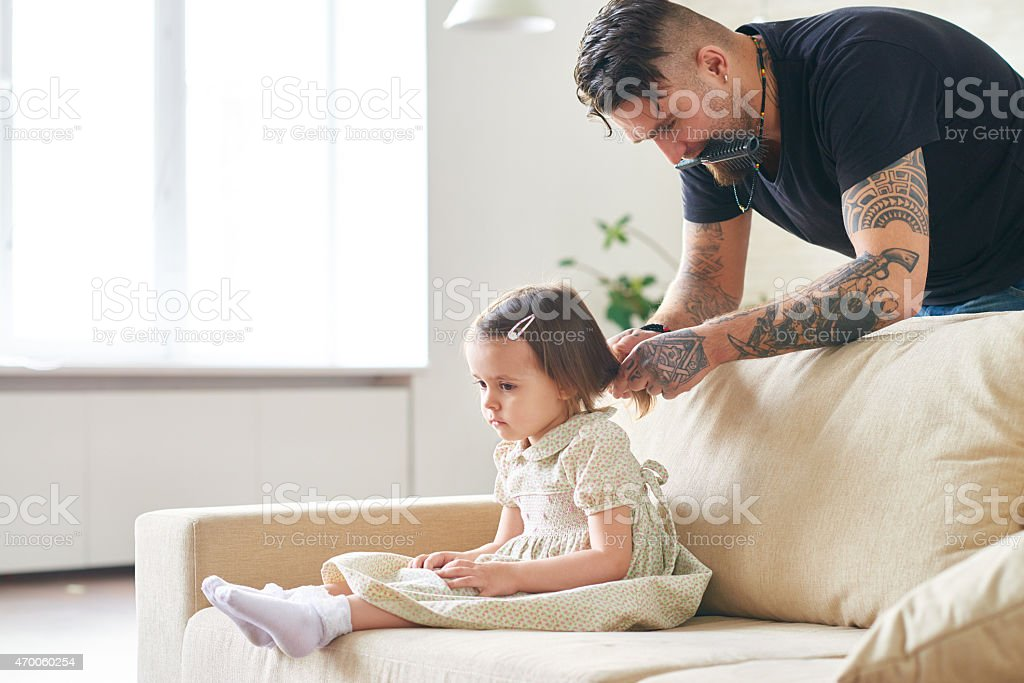 Doing hair for preschool stock photo