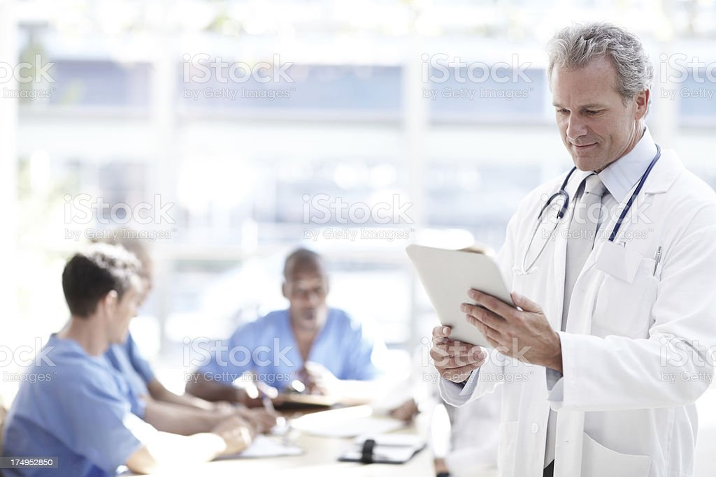 Doing his daily check royalty-free stock photo