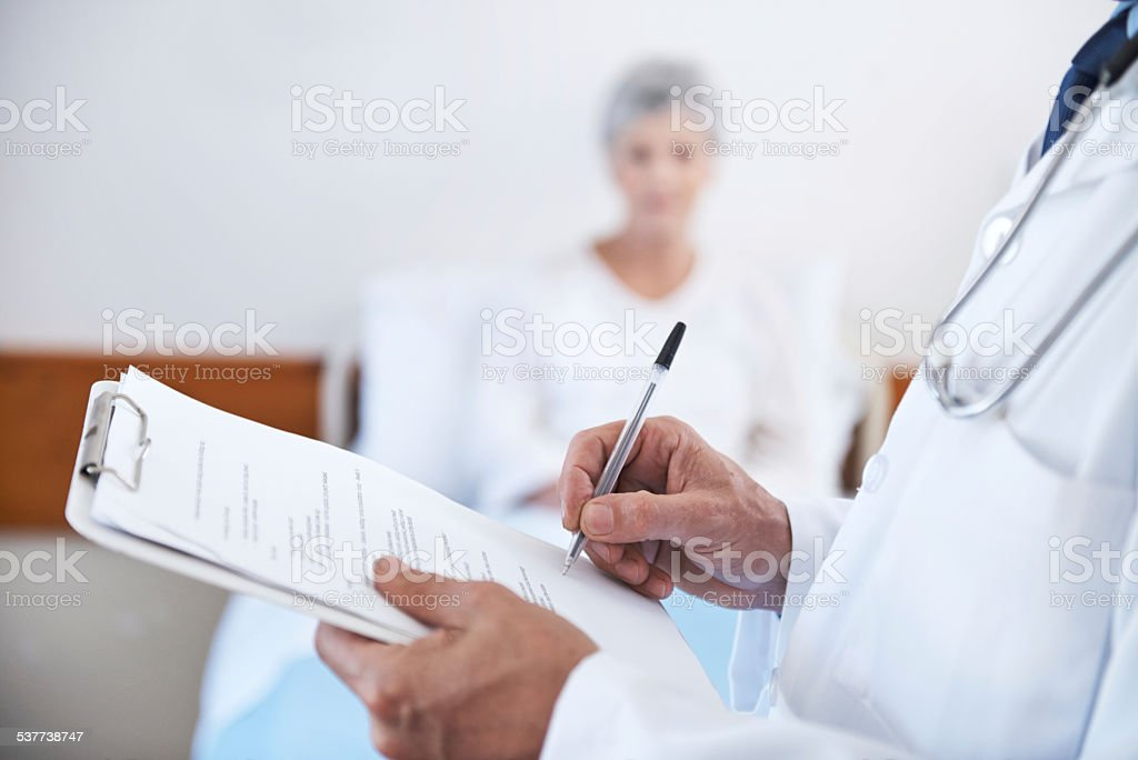 Doing his daily checkup stock photo