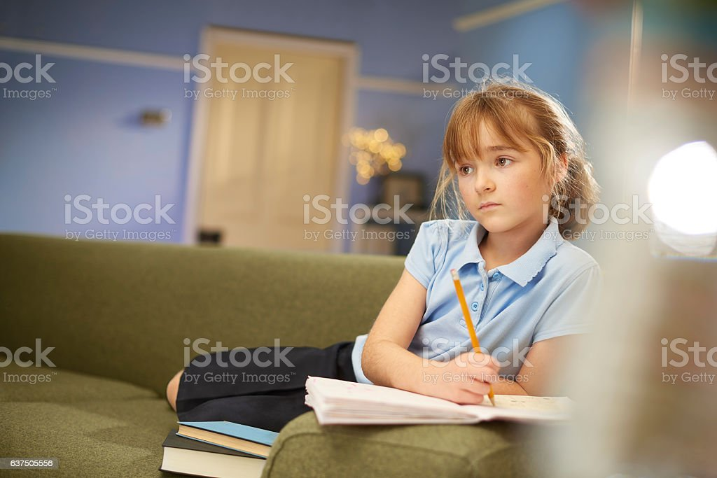 doing homework in front of tv stock photo