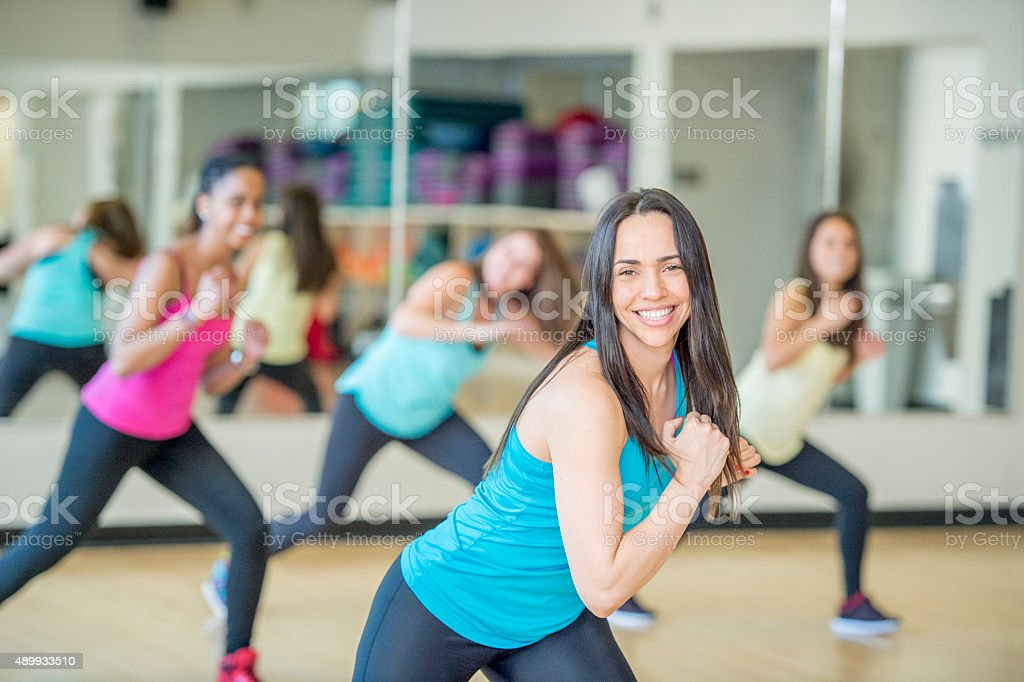 Doing Lunges in a Dance Fitness Class stock photo