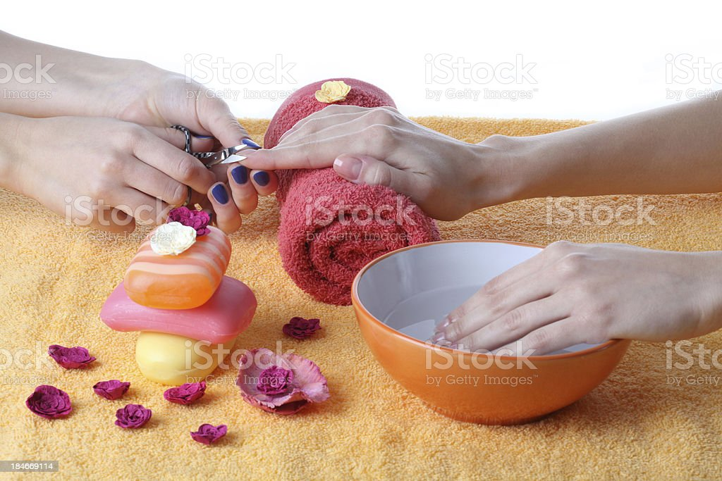 Doing manicure royalty-free stock photo