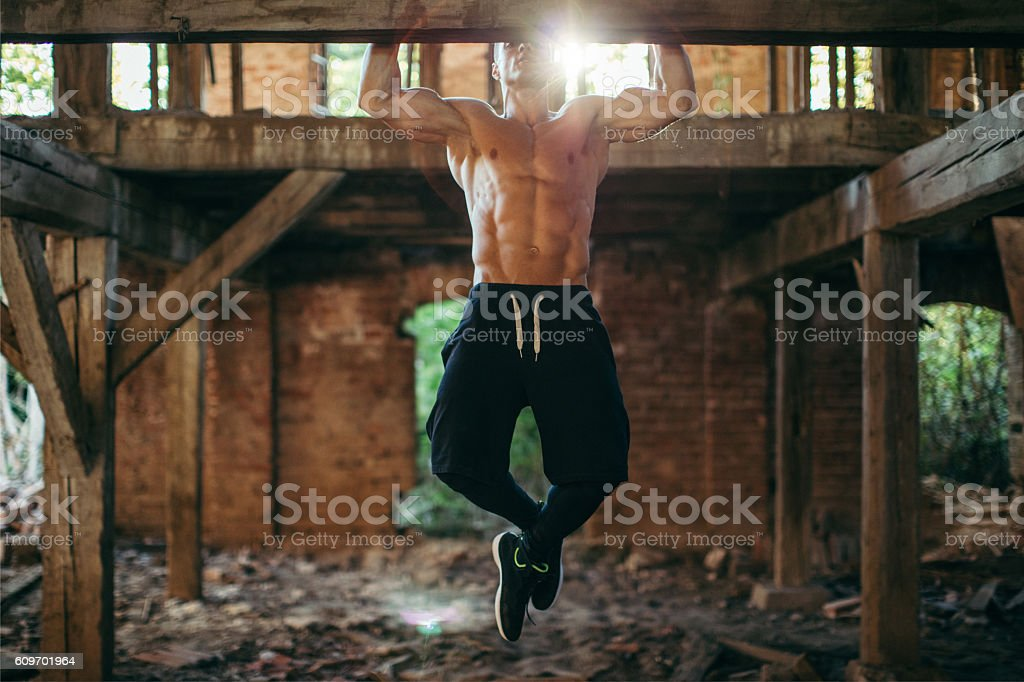 Doing pull ups stock photo
