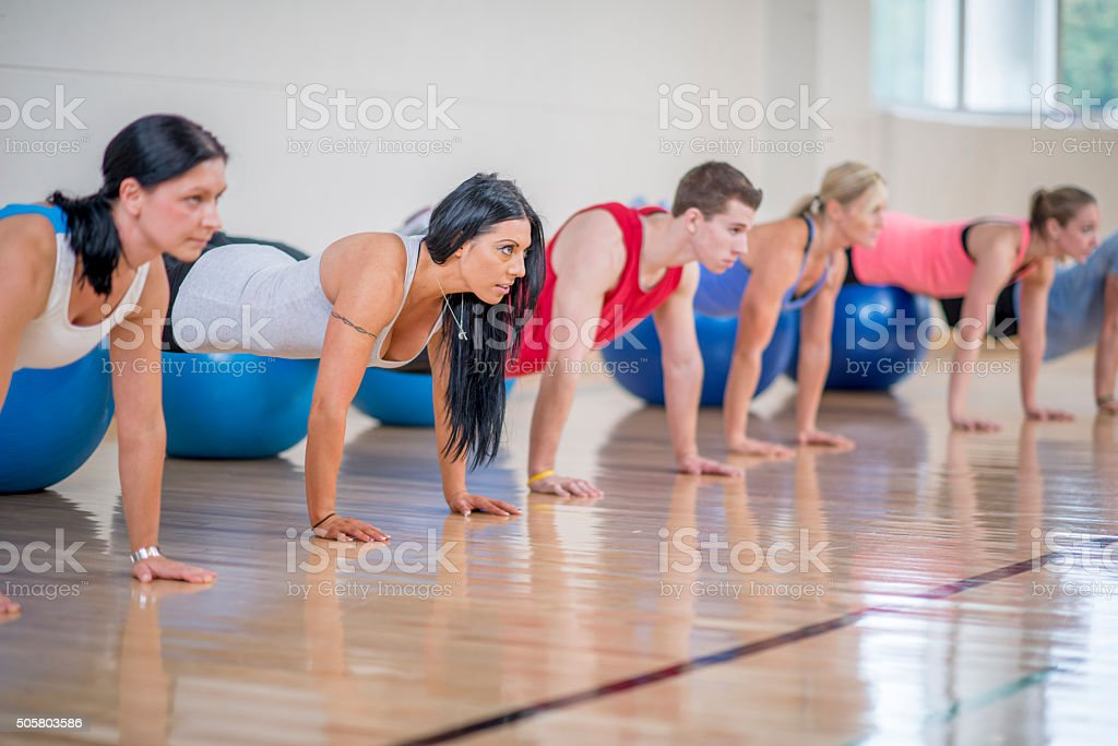 Doing Pushups at the Gym stock photo